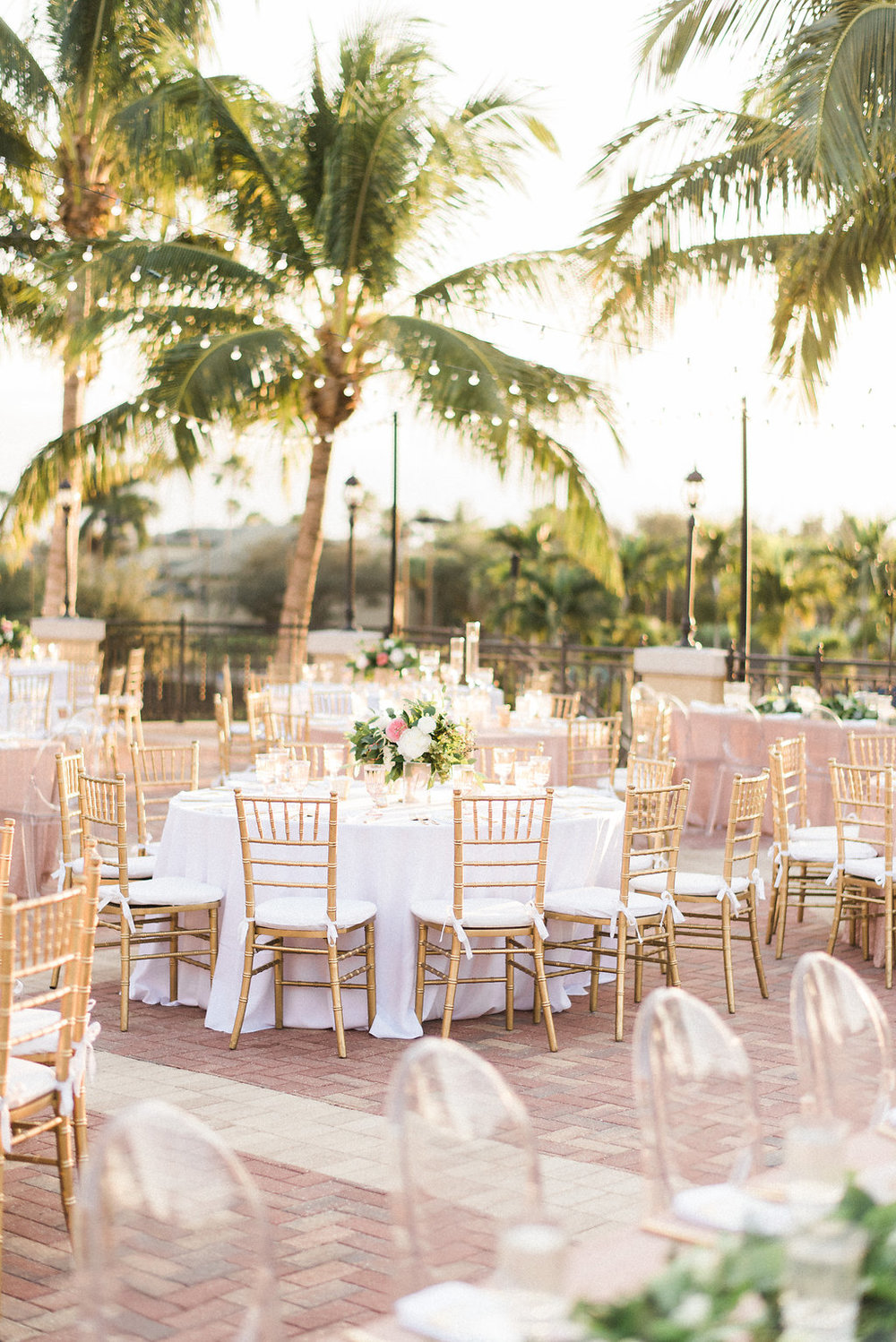 Blush and Gold wedding reception with gold chiavari chairs