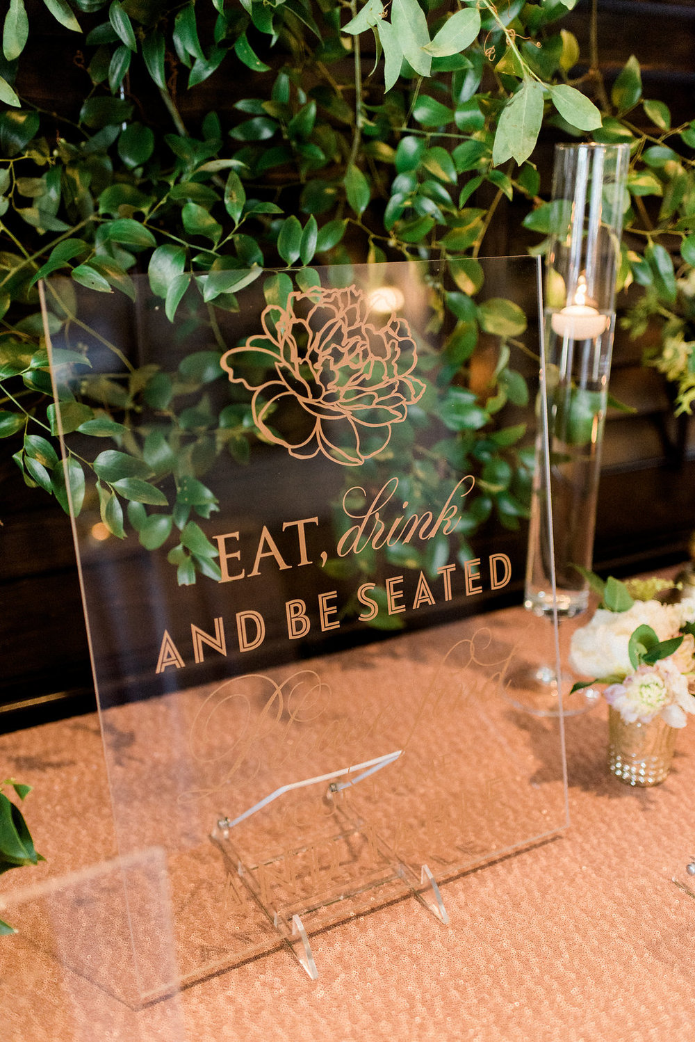 Gold, blush, and acrylic seating chart with vines