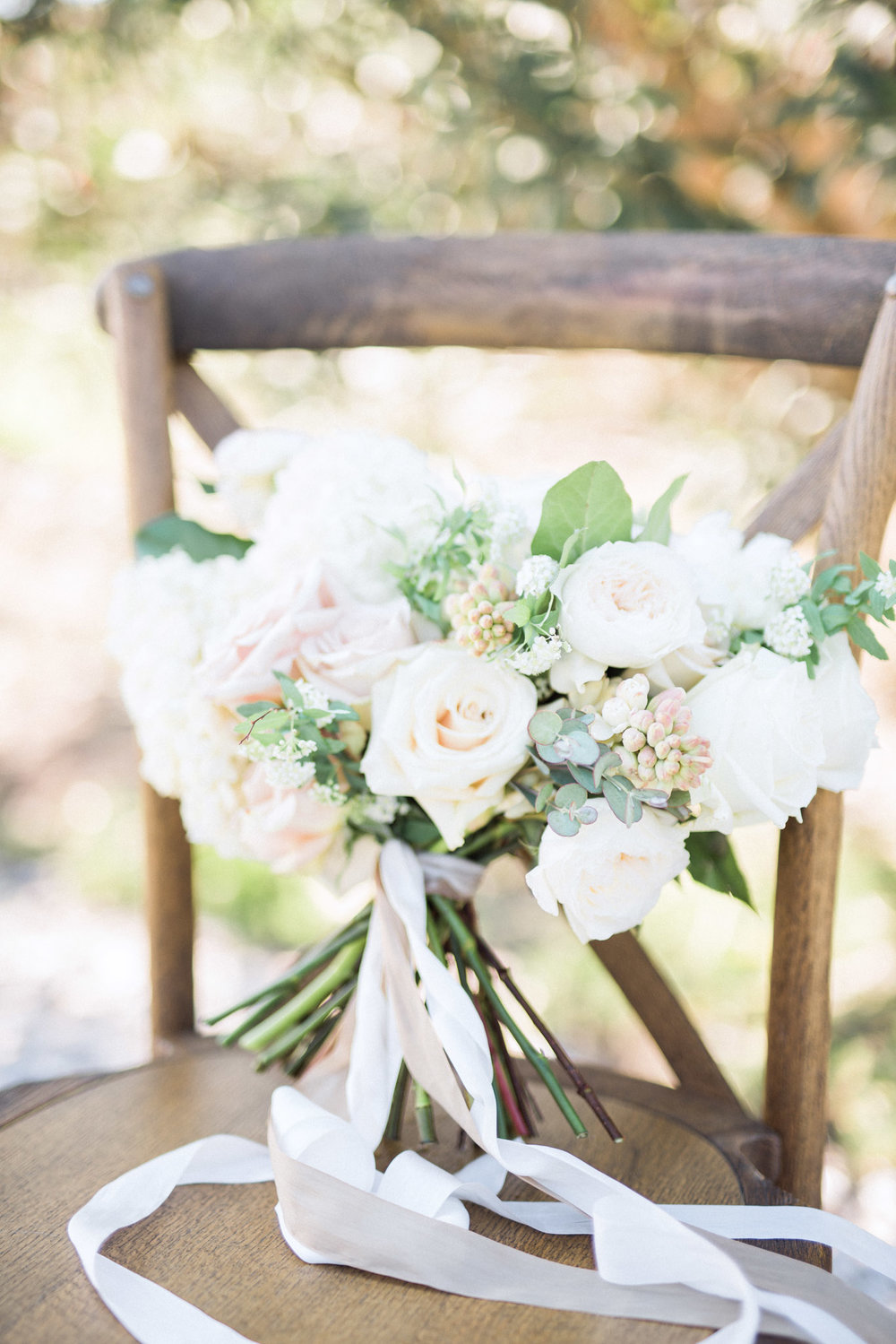 garden style bouquet with white florals & greenery