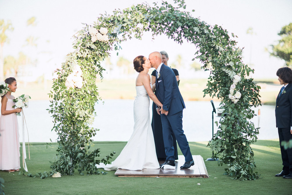First kiss for newlyweds during ceremony