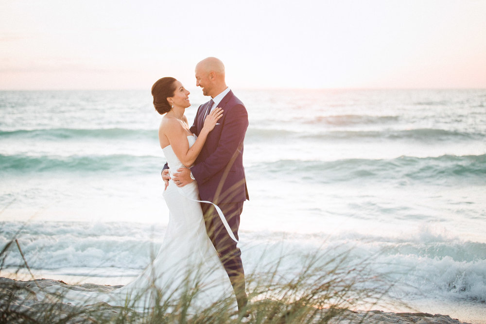 beachfront wedding photo of bride and groom