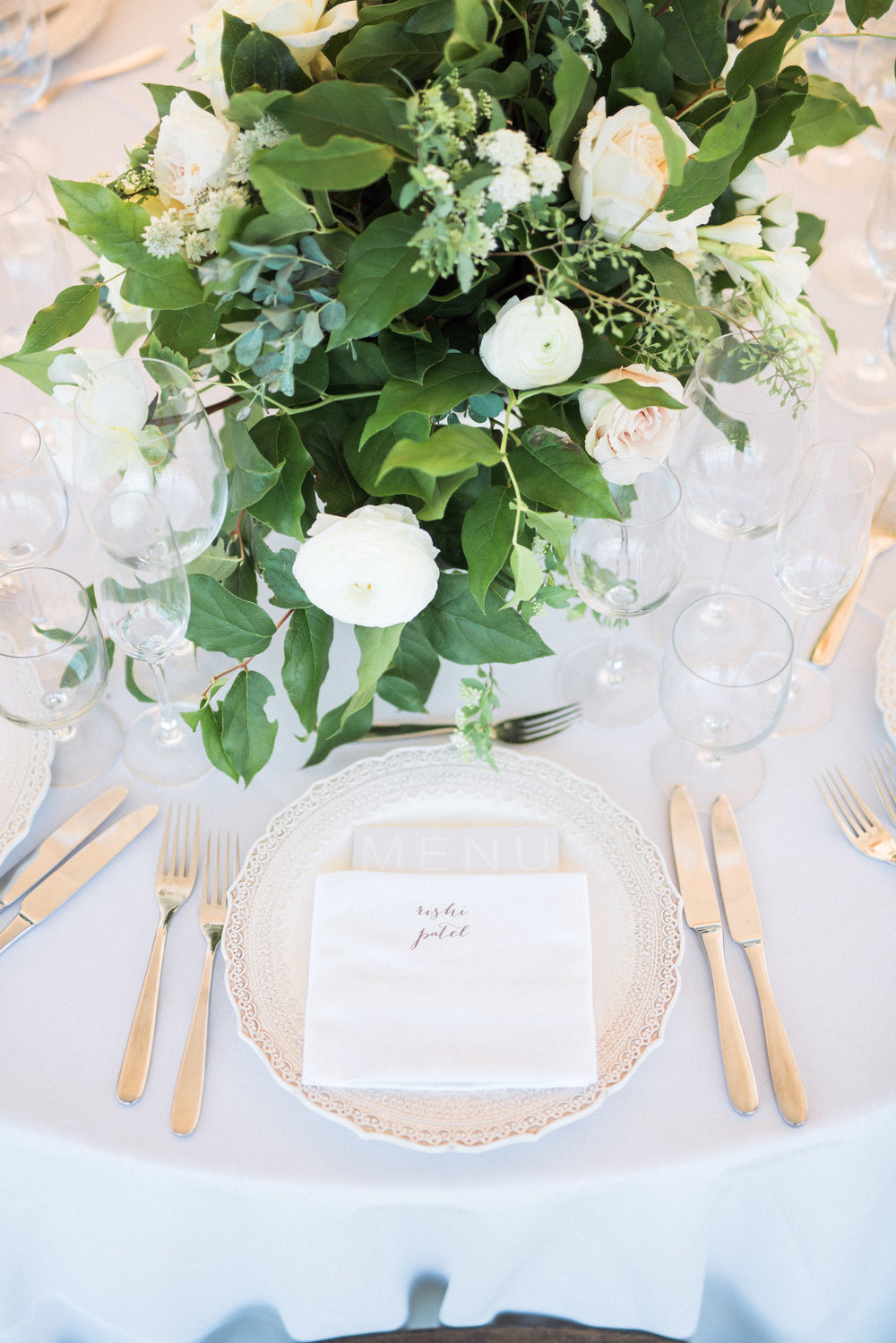 Wedding reception all white and silver place setting