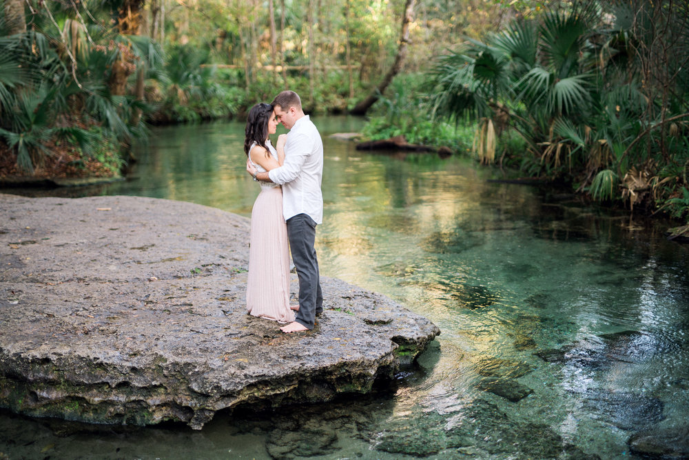 Styled engagement photo of bride and groom at Wekiwa Springs State Park