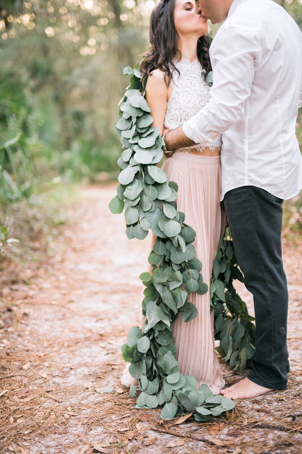 Eucalyptus garland used as greenery/floral shrug for styled engagement shoot at Wekiwa Springs State Park
