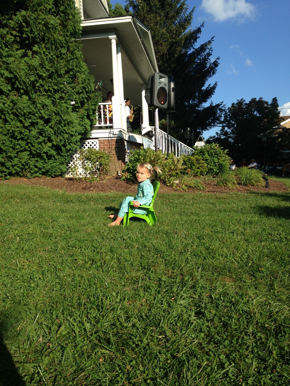 Ruby Putnam enjoys the sunny lawn at the Jones House.