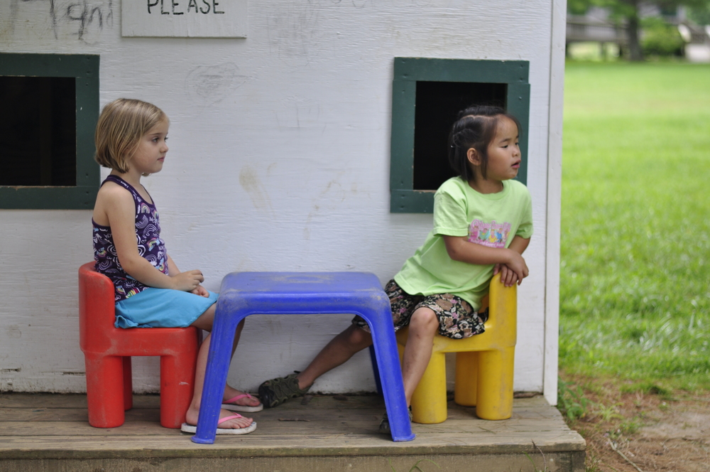 Sophie Law and Carolina Klear enjoy some fun at the mini house village at Valle Crucis Park.  Photo by Athalia Whitworth.