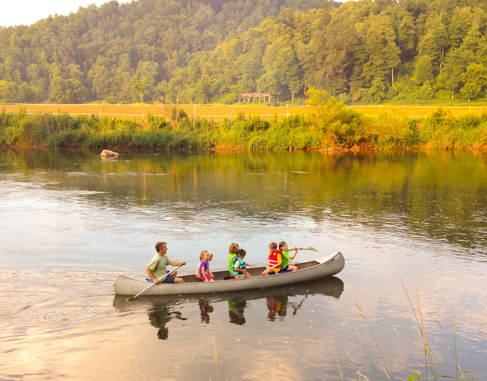 The Klear's children canoe down the New River with friends.