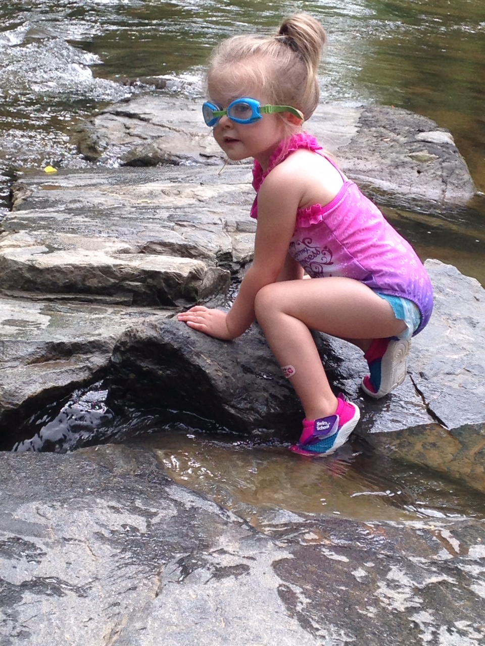 Reagan Peavy, daughter of Rich & Kristan, has a great time in the Watauga River at Valle Crucis Park.