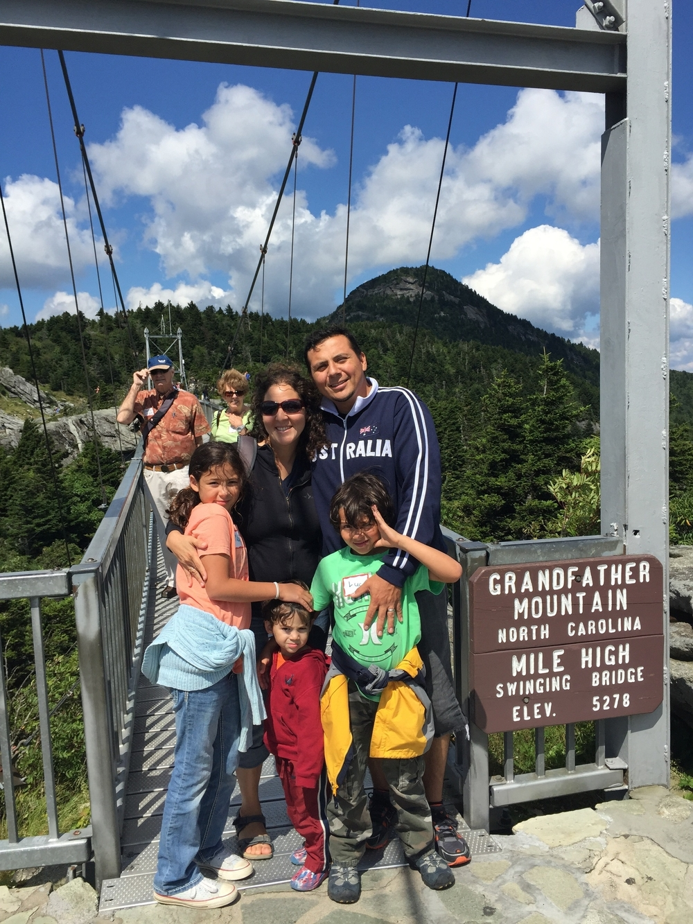 Iris and her family enjoy Grandfather Mountain.  She is joined by her husband, Edgar (serves with OCC International) and their children, Maia, Lucas and Noah Luciano.