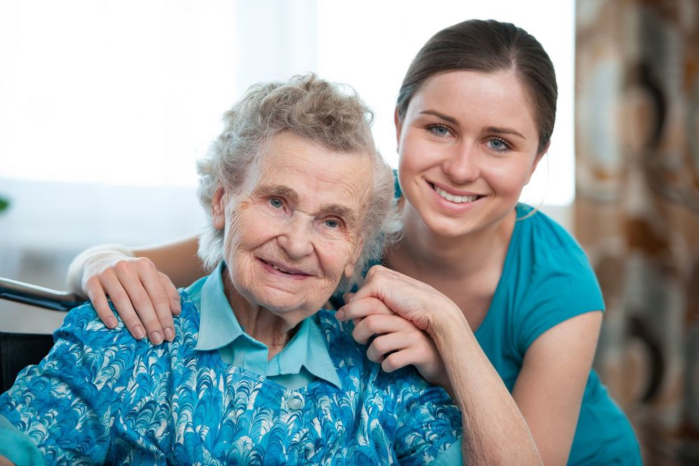 Aged Care Services Worker With Patient