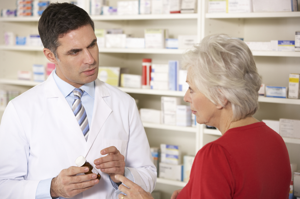 Local Chemist & Customer Discussing Aged Care Medication