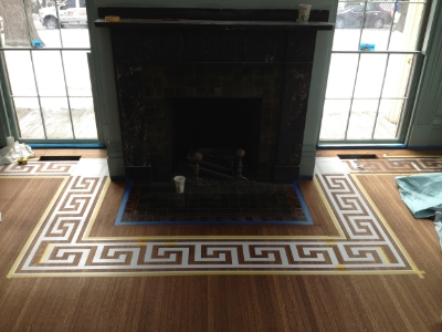"""Stencil wrapped around hearth with corner """"turns"""""""