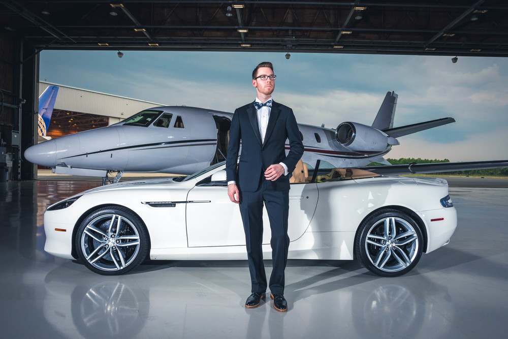 Tuxedo: Armani Collezioni(courtesy Saks Fifth Ave.), Shirt: Ledbury, Tie: The Tie Bar, Shoes: Crosby Square, Glasses: Burberry, Car: 2014 Aston Martin DB9 Volante(courtesy Foreign Cars Italia), Photo: Alec Hutchins Photography, Model: Noah Williams