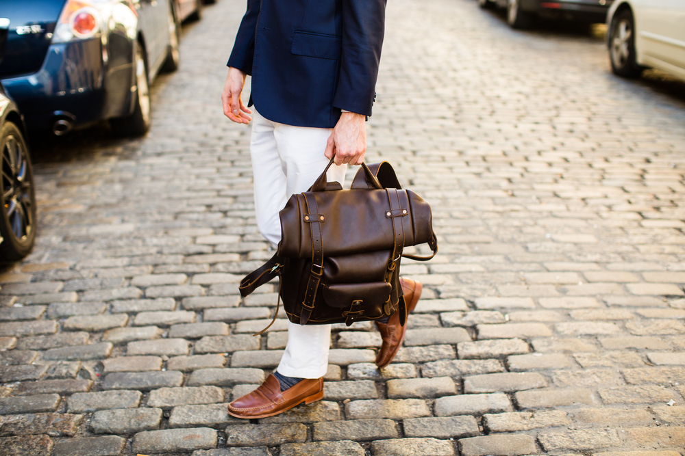 Suit jacket: J. Lindeburg. Pants: Banana Republic. Sweater: Jcrew. Shirt: Brooks Brothers. Pocket Square: Cotten Brew. Shoes: Johnston & Murphy. Glasses: Ralph Lauren. Bag: Pad & Quill