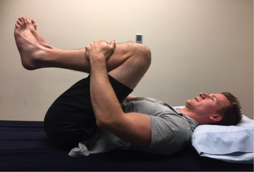 Flexion stretch in lying: