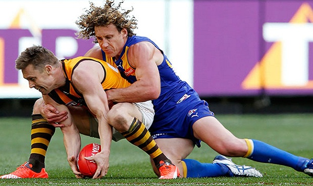 Matt Priddis lays a tackle on new West Coast recruit Sam Mitchell