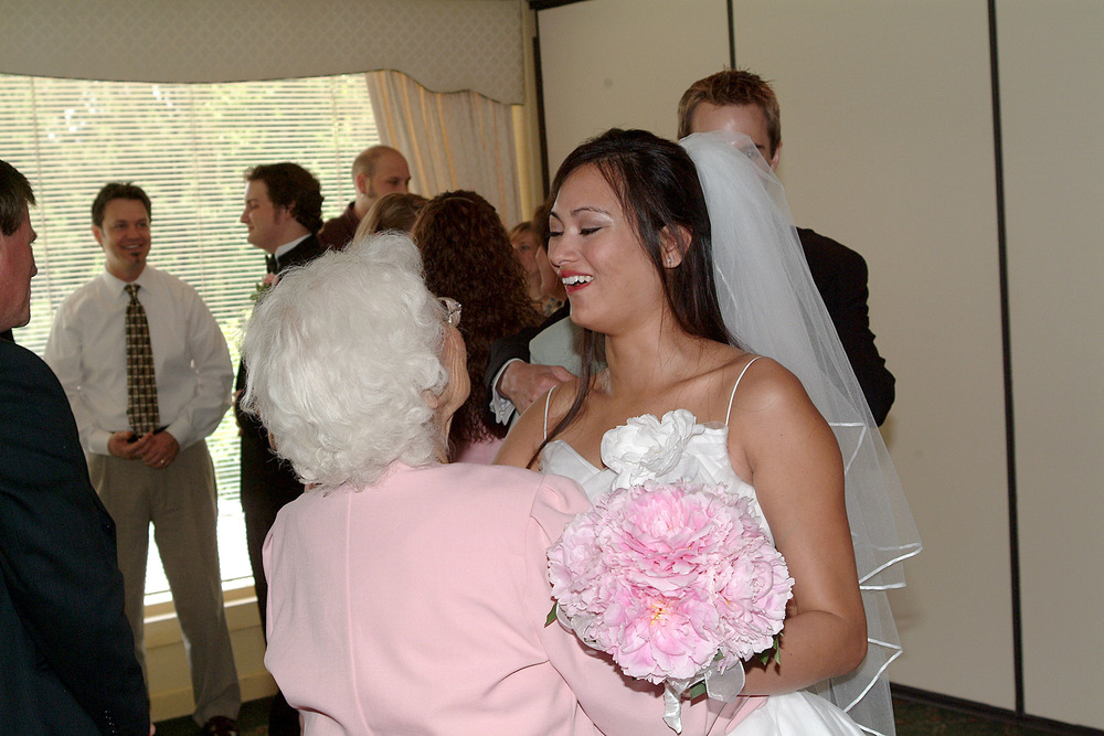 "Again... SUPER FLATTERING PHOTO OF ME. Ha. Here I'm telling my grandma that it's okay that she stood up in the middle of my wedding and shouted, ""I CAN'T HANDLE THIS!"" (She was overcome with emotion-- mainly regret that my grandpa couldn't travel to Atlanta for the wedding and that my dad wasn't alive to witness this ""glorious"" day). My aunt, in a demonic voice, growled ""SIT. DOOOOOWWNNNNN!""."