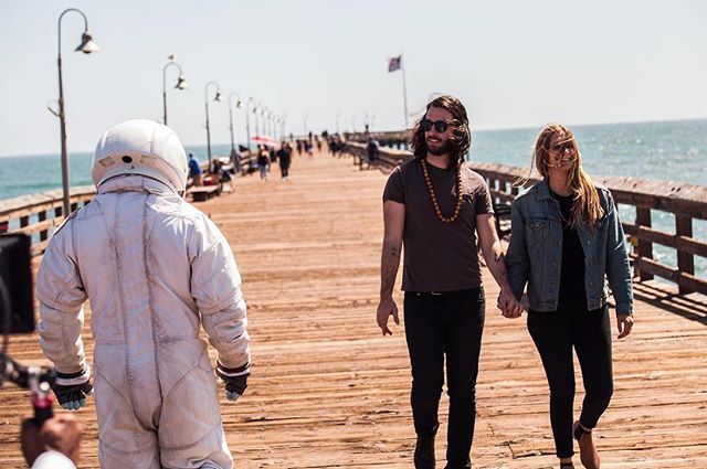 I feel like it it's weird that there's an astronaut just walking the pier... Maybe not, I don't know, it could have just been a dream. — 'Pull Me In' Music Video // #bts #braeves // 📷 @aristotledreher