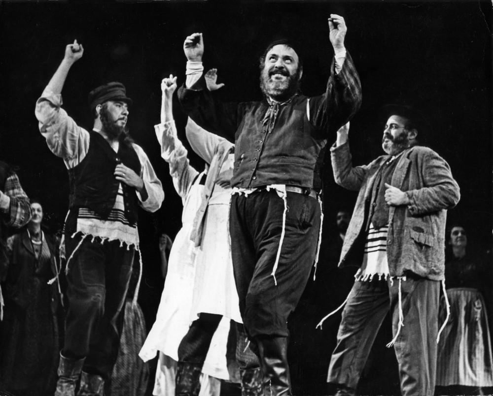 "Zero Mostel leads the company of  Fiddler on the Roof  in ""Tradition."""