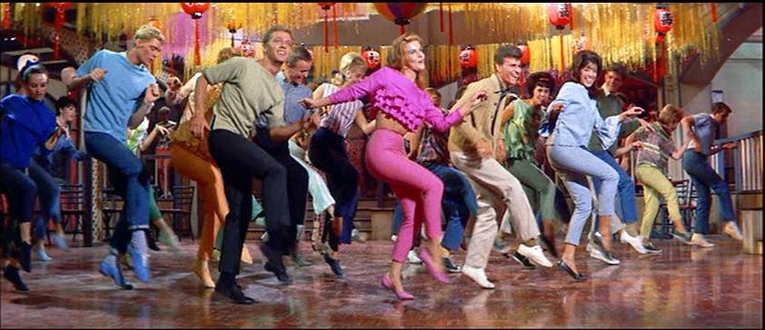 "Ann-Margaret leads ""A Lot of Livin'"" in the film."