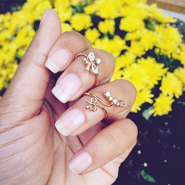 "So pretty! Find these rings in the ""Dainty Collection"" section on our site 💕 #ishopcandy #rings #midirings #dainty #manicure #delicate #hands #jewelry"
