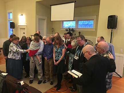 Previously ordained elders laying on hands at ordination and installation of ruling elders.