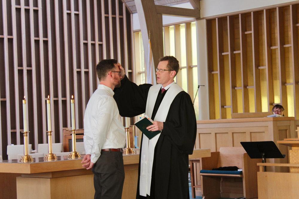 Rev. Greg Ellis performs ordination service for Seth Thomas