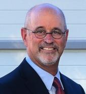 Dr. Neil Tibbott