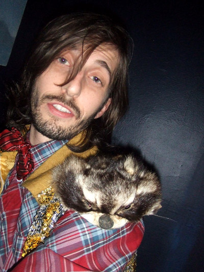 Racoon head on shoulder.