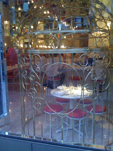 What the frick is this place? New, unmarked restaurant on Greenwich and 11th with crazy bird cage table in window…