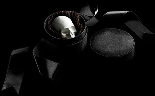 """Decaaaadeeeence!   """"The genesis of  DL & Company 's gastronomic collaboration with Valerie Confections is the belief that any modern luxury brand should appeal to all of the senses. Both known for extravagant packages that delight the eye and hand… Loosely translated, MORI EX CACAO is Death by Chocolate – dangerously overwhelming indulgence. These marvelous and macabre chocolate skulls are among the most extravagant confections made today…"""" ( via.. )"""