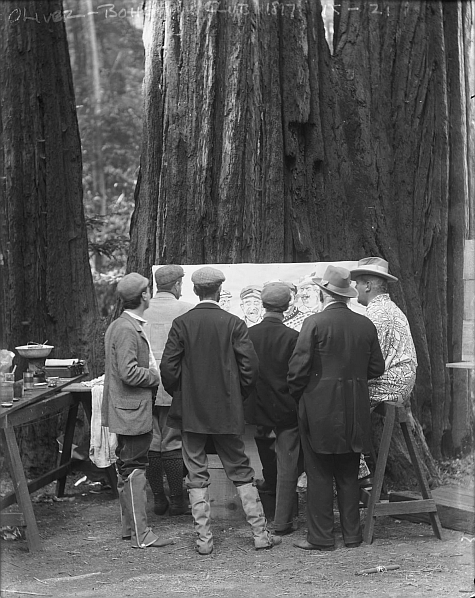 "A group of Bohemians crowd around a painting  (1926). From my new favorite blog,  If Charlie Parker were a Gunslinger…  in the series  Fun at Bohemian Grove .   Wikipedia: ""  Bohemian Grove   is a 2,700-acre campground located at 20601 Bohemian Avenue, in Monte Rio, California, belonging to a private San Francisco-based men's art club known as the Bohemian Club. In mid-July each year, Bohemian Grove hosts a three-week encampment of some of the most powerful men in the world…   The Bohemian Club's all-male membership includes artists, particularly musicians, as well as many prominent business leaders, government officials (including many current and former U.S. presidents), and senior media executives, and people of power.   As a measure of the club's exclusivity, it is reported the waiting list for membership is from 15 to 20 years…   A statue of an owl stands at the head of the lake in the Grove. Since 1929, the Owl Shrine has served as the backdrop of the yearly  Cremation of Care  ceremony…   The ceremony involves the poling across a lake of a small boat containing an effigy of Care (called ""Dull Care""). Dark, hooded figures receive from the ferryman the effigy which is placed on an altar and at the end of the ceremony, is set on fire. This 'cremation' symbolizes that members are banishing the ""dull cares"" of conscience…   ' The Bohemian Grove, that I attend from time to time — the Easterners and the others come there — but it is the most faggy goddamn thing that you would ever imagine. The San Francisco crowd that goes in there, it's just terrible. I can't even shake hands with anybody from San Francisco.' — President Richard M. Nixon, Bohemian Club member starting in 1953.""   Okay, now I'm obsessed."