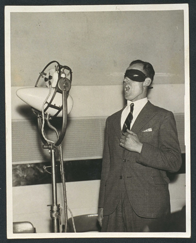 Masked mystery man sings into microphone during BBC rehearsal, Gelatin silver print 1934 (via  National Media Museum )  beatnik-yoga