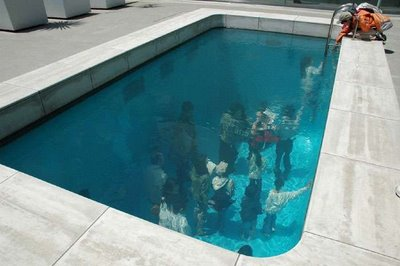 I've experienced this ( see pic ). It's pretty nuts.    devincastro :      Swimming Pool Art Illusion  This is a swimming pool art  installation  in the 21st Century Museum of Art of Kanazawa by artist  Leandro Erlich . There are two clear acrylic glasses about a foot apart and water is filled inside. The top surface is also filled with about 4 to 5 inches of water so that it just looks like water. The people underneath the swimming pool can actually look above with realistic water effect on top of it.  This art installation is epic genius; I admire the illusion. For a youtube video of this,  click here .