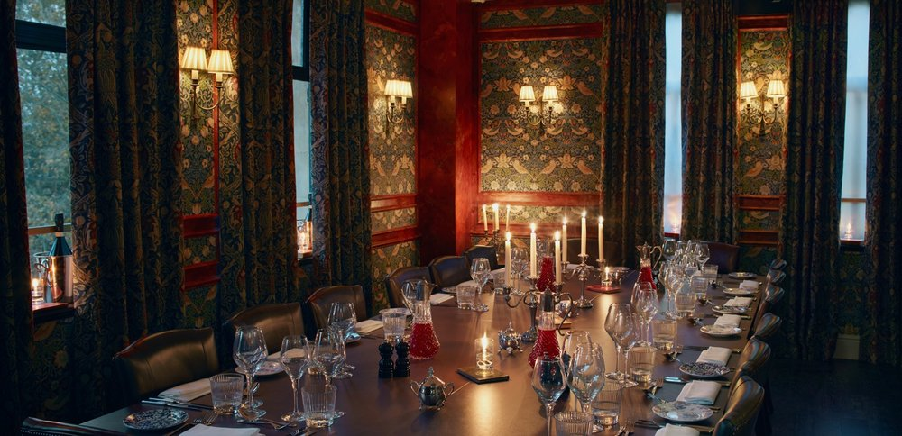 Six Storeys interior, a large table set for dinner, candlelit