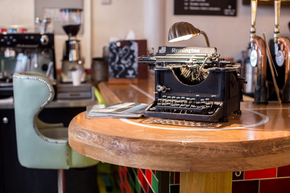 Tanner & co interior, q 19th century typewriter on a thick wooden table