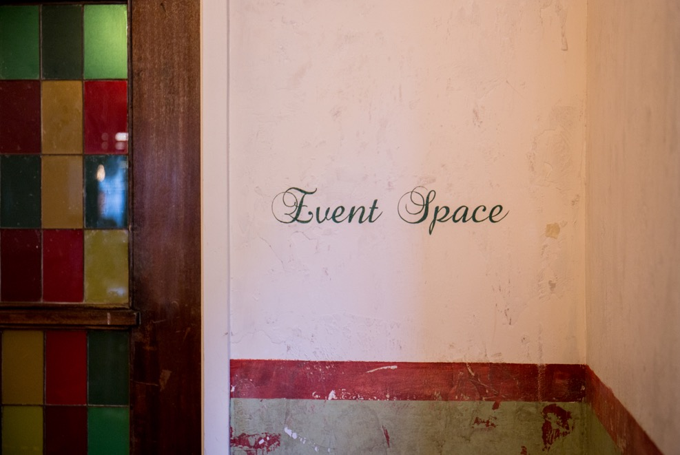 Tanner Warehouse interior, the phrase Event Space written on the wall calligraphic brush script