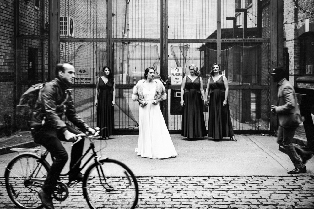 A cyclist just about to ride in front of the bride