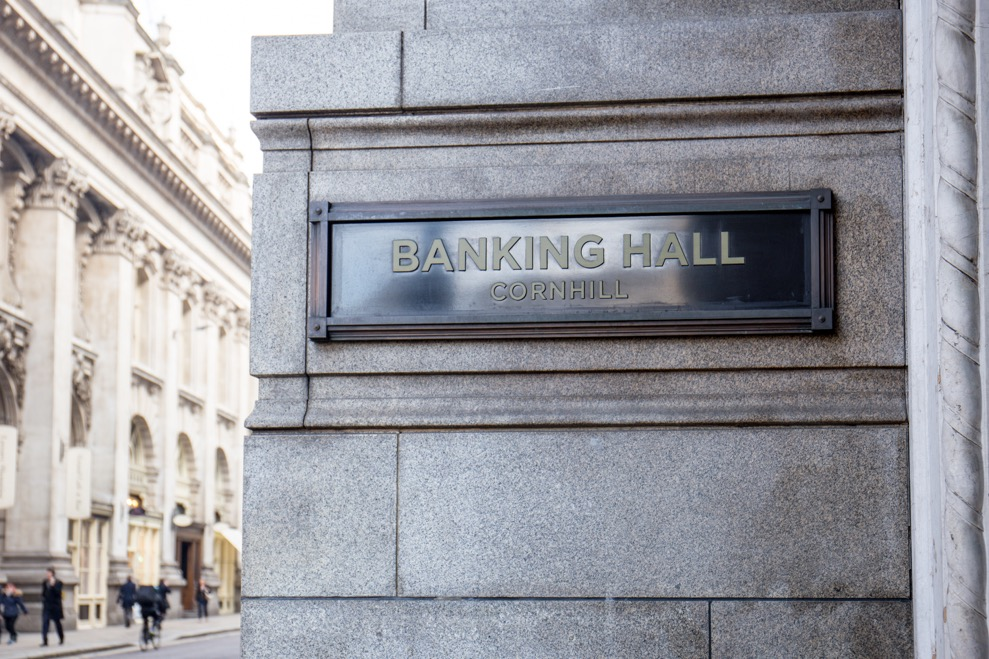 Banking hall exterior, a brass plate with the venue's name engraved on it,  on an outside wall
