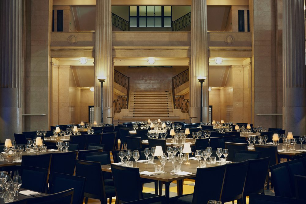 Banking Hall interior, rows of tables, each seating up to eight people, set for dinner in the banqueting hall