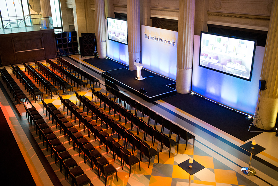 Banking Hall interior, 6 rows of seating, 30 chairs a row, set up for a presentation shown on three large screens