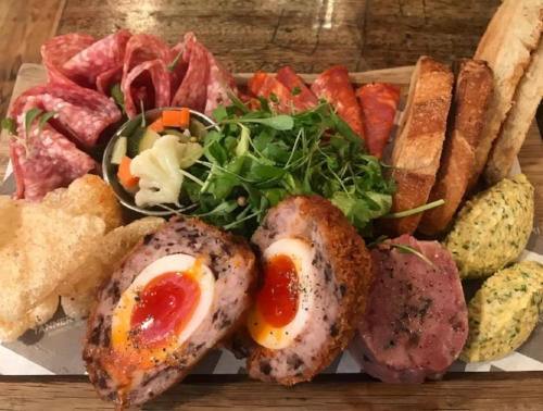 THE MEAT BOARD OF THE array of STARTERS TO SHARE.