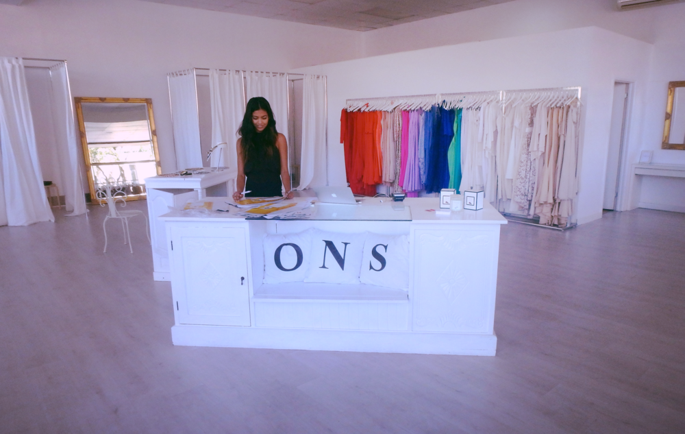Shop assistant Sonali enjoying the rare occasion of a quiet day at ONS.