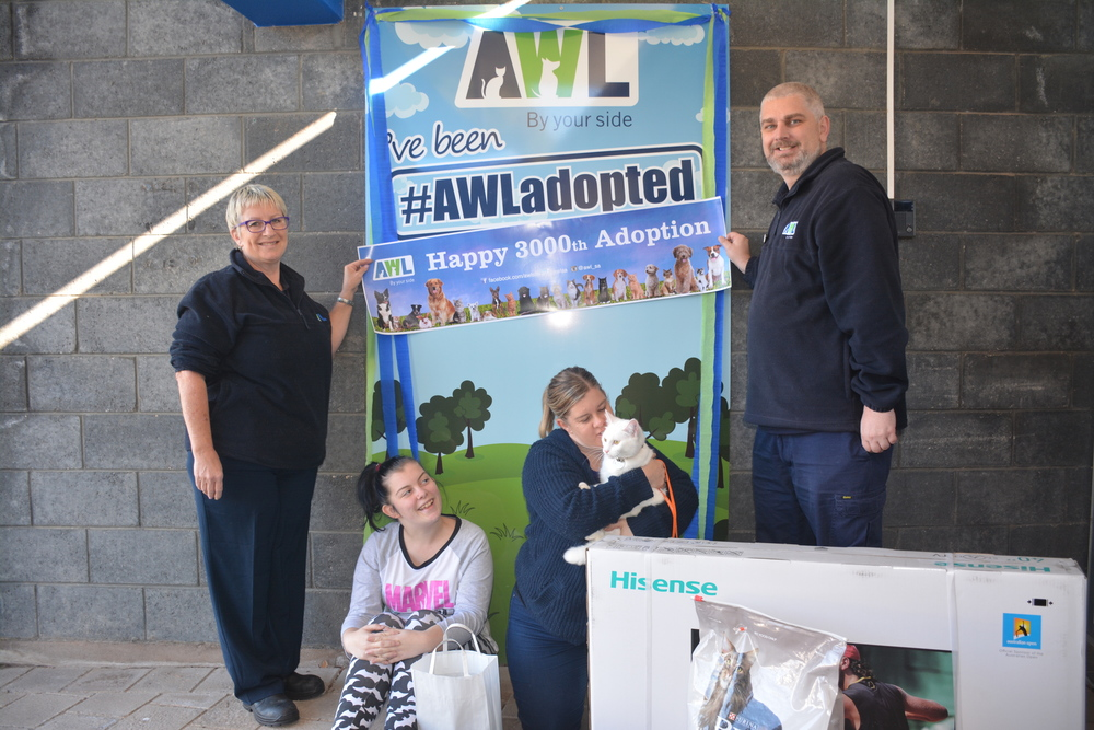 AWL Staff members Natalie and Troy with lucky Lilyia and her new owners, Renee and Wendy. Photo via AWL SA