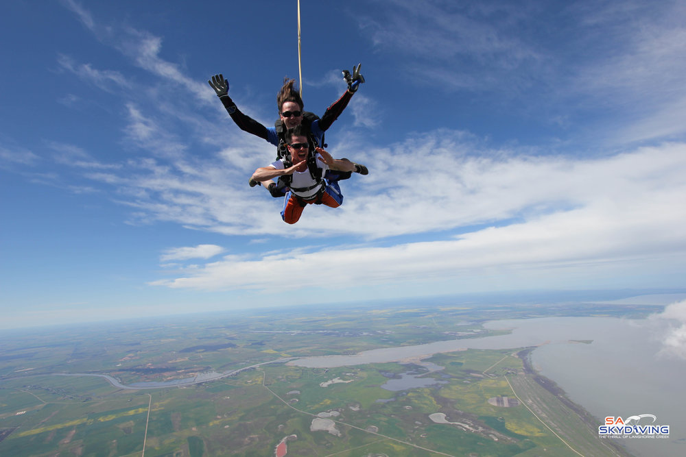 Skydiving while trying to macerena, accomplished.