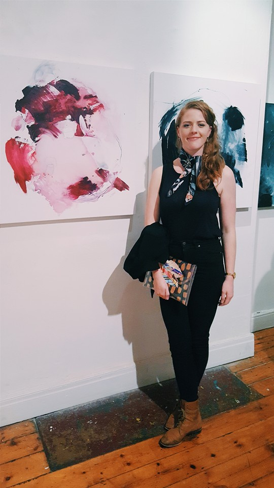 A proud Porteous stands with a selection of her art at the 'Second Nature' exhibition.