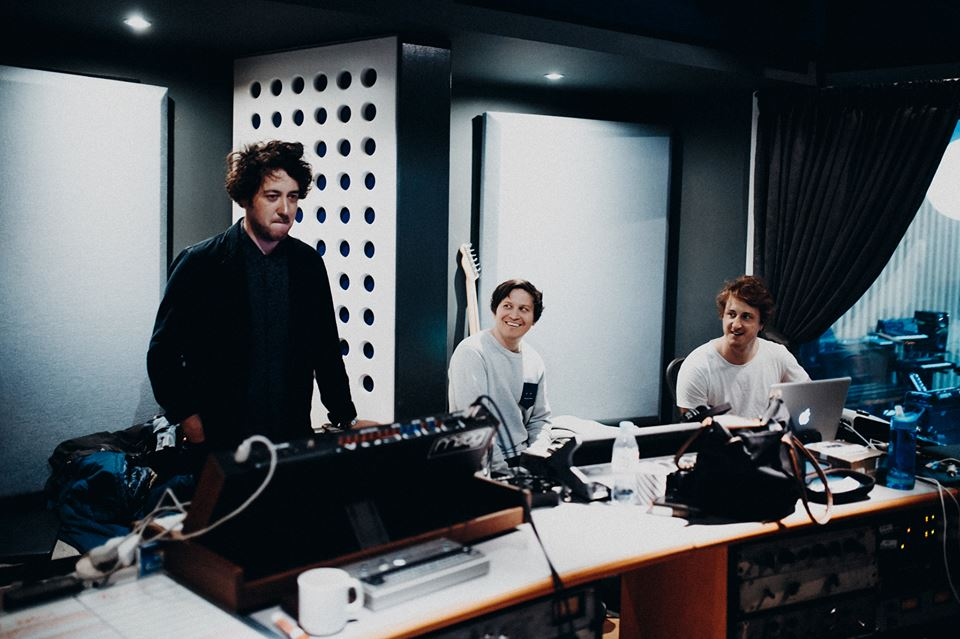 The band captured during recording for their fourth album