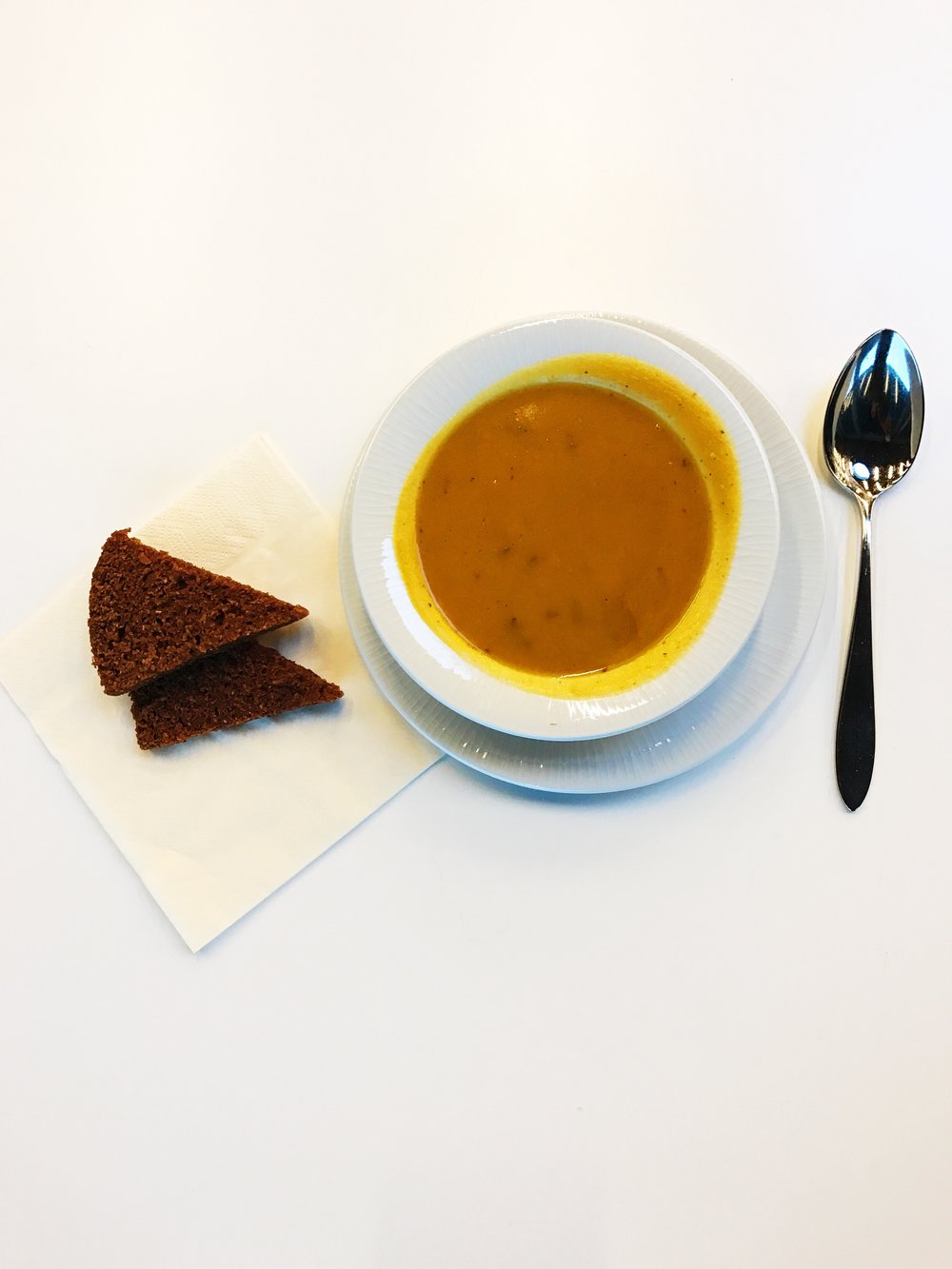 Coconut, carrot and ginger soup with a side of rye bread.