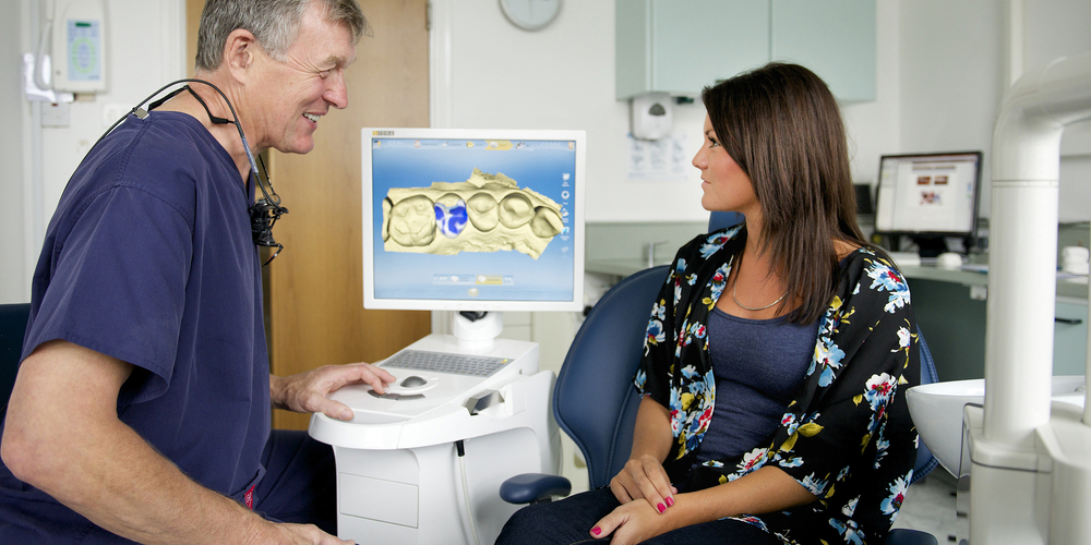 Rob discussing the CEREC treatment with a patient.