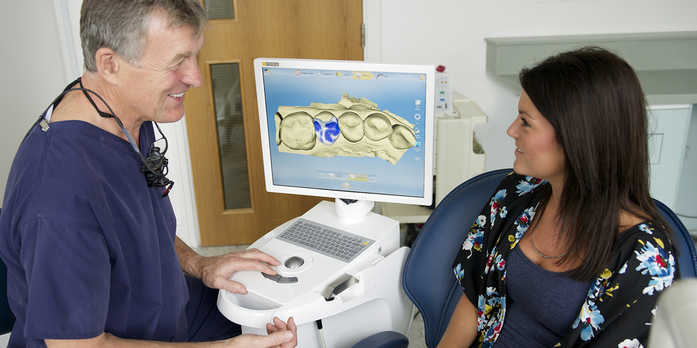 Rob discussing a CEREC treatment with a patient.